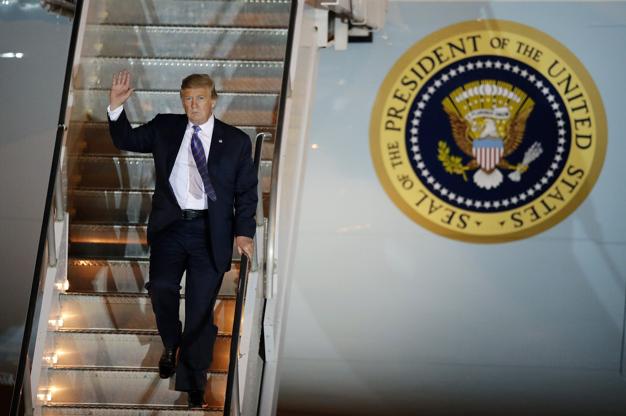 US President Donald Trump disembarks from Air Force One after arriving at Mc Carran International Airport