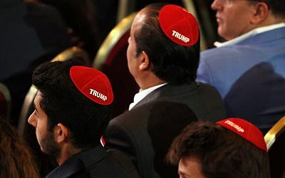 Men attending the Republican Jewish Coalition's annual leadership meeting wear red yarmulkes with the word 'Trump' on them, April 6, 2019, as they wait for President Donald Trump to arrive to speak in Las Vegas. (AP Photo/Jacquelyn Martin)