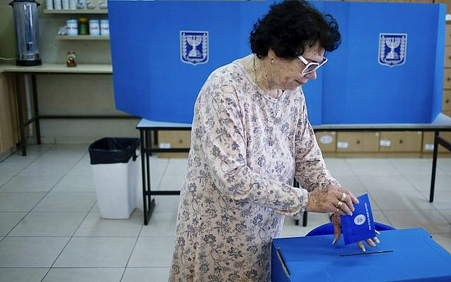 A woman votes at a polling station in the West Bank settlement of Efrat, on April 9, 2019. (AP Photo/Ariel Schalit)