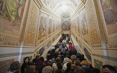 Faithful kneel on the newly restored Holy Stairs (Scala Sancta), which according to Catholic Church is the staircase on which Jesus Christ stepped leading on his way to be judged before his crucifixion, during a special opening, in Rome, April 11, 2019. (AP Photo/Andrew Medichini)