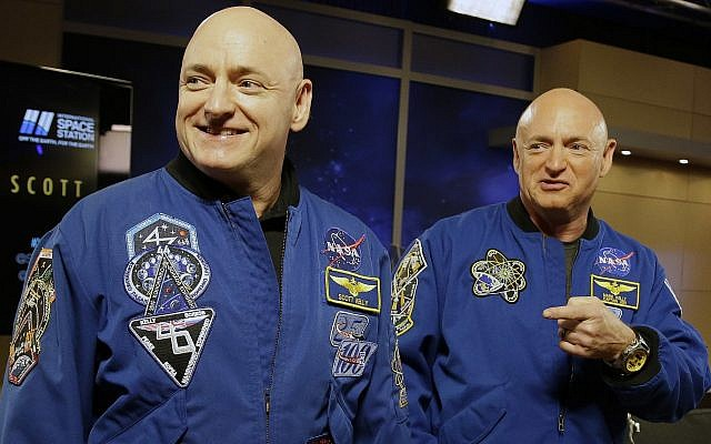 FILE - In this March 4, 2016 file photo, NASA astronaut Scott Kelly, left, and his identical twin, Mark, stand together before a news conference in Houston (AP Photo/Pat Sullivan, File)