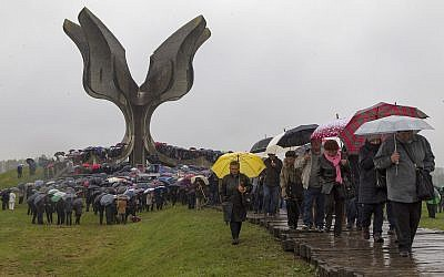Hundreds gather at the memorial center to pay their respects for tens of thousands of people killed in death camps run by Croatia's pro-Nazi puppet state in WWII, in Jasenovac, Croatia, Friday, April 12, 2019. (AP Photo/Nikola Solic)