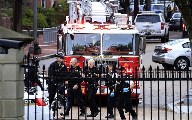 US Secret Service officers on Pennsylvania Avenue seen from inside the White House after a man reportedly set himself on fire, prompting a lockdown of the White House. April 12, 2019. (AP Photo/Manuel Balce Ceneta)