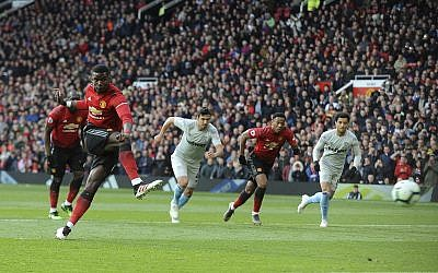 Manchester United's Paul Pogba scores the opening goal from the penalty spot during the English Premier League soccer match between Manchester United and West Ham United at Old Trafford in Manchester, England, Saturday, April 13, 2019. (AP/Rui Vieira)