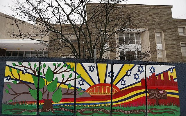 This photo from Feb. 11, 2019 shows artwork on a fence around the Tree of Life Synagogue in Pittsburgh where 11 people were killed and seven others injured during an attack on in October of 2018 (AP Photo/Keith Srakocic, File)