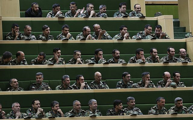 A group of Iranian army members follow the debates of parliament on a tour on the occasion of Army Day on Thursday, in Tehran, Iran, Tuesday, April 16, 2019. (AP Photo/Vahid Salemi)