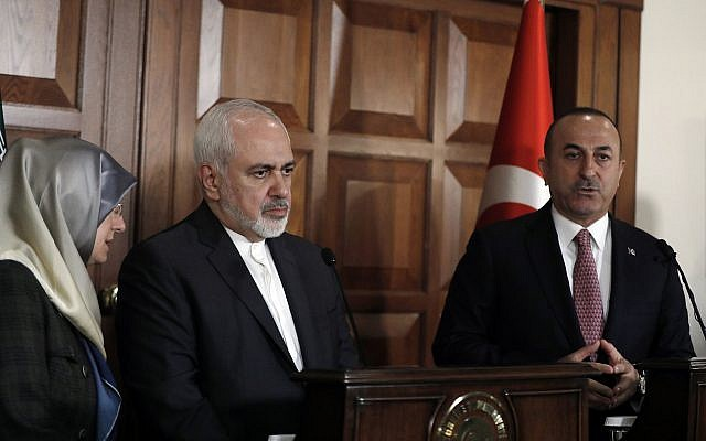 Turkish Foreign Minister Mevlut Cavusoglu, right, and Iran's Foreign Minister Mohammad Javad Zarif speak during a joint news conference in Ankara, Turkey, April 17, 2019. (AP Photo/Burhan Ozbilici)