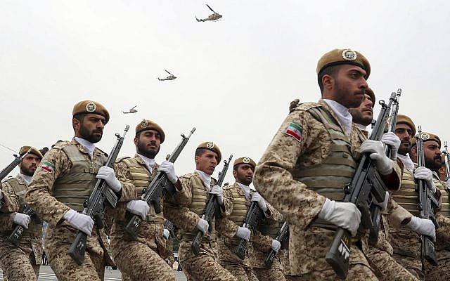 In this photo released by the official website of the office of the Iranian Presidency, troops march in a military parade marking National Army Day in front of the shrine of the late revolutionary founder Ayatollah Ruhollah Khomeini, just outside Tehran, Iran on April 18, 2019. (Iranian Presidency Office via AP)