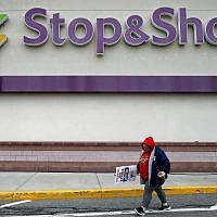 A striking workers walks outside the Stop & Shop supermarket in Revere, Mass., Thursday, April 18, 2019. (AP/Michael Dwyer)