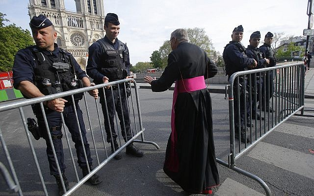 Notre Dame Cathedral rector Jean-Marc Chauvet enters the security perimeter to Notre Dame, April 18, 2019 in Paris. (AP/Michel Euler, Pool)