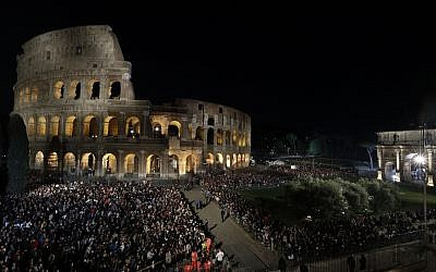 A view of the Colosseum, lit ahead of Pope Francis arrival for the Via Crucis (Way of the Cross) torchlight procession on Good Friday April 19, 2019. (AP Photo/Andrew Medichini)