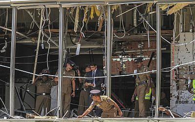 A Sri Lankan Police officer inspects a blast spot at the Shangri-la hotel in Colombo, Sri Lanka, April 21, 2019. (AP/Chamila Karunarathne)