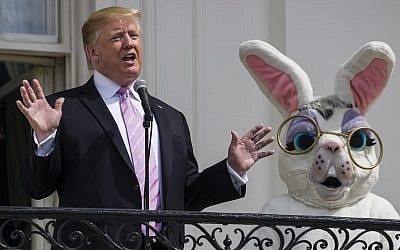 US President Donald Trump, joined by the Easter Bunny, speaks from the Truman Balcony of the White House in Washington on April 22, 2019, during the annual White House Easter Egg Roll. (AP Photo/Alex Brandon)