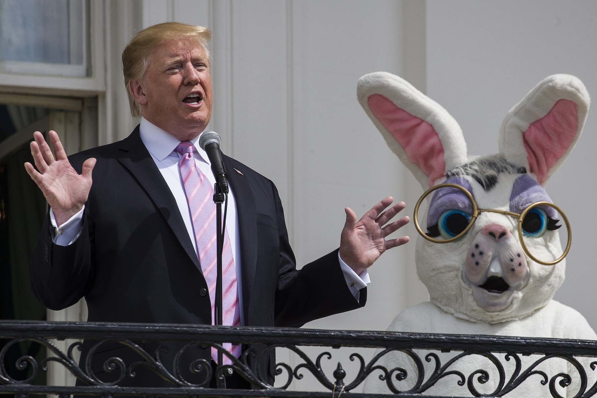 US President Donald Trump joined by the Easter Bunny speaks from the Truman Balcony of the White House in Washington