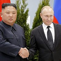 Russian President Vladimir Putin, right, and North Korea's leader Kim Jong Un shake hands during their meeting in Vladivostok, Russia, April 25, 2019 (AP Photo/Alexander Zemlianichenko, Pool)