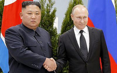 Russian President Vladimir Putin, right, and North Korea's leader Kim Jong Un shake hands during their meeting in Vladivostok, Russia, April 25, 2019 (AP Photo/Alexander Zemlianichenko, Pool)