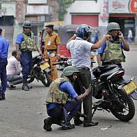 Sri Lankan navy soldiers perform security checks on motorists at a road in Colombo, Sri Lanka, April 25, 2019. (AP/Eranga Jayawardena)