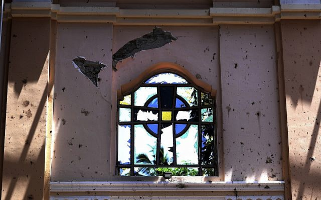 In this April 25, 2019 photo, a stained-glass window stands broken at Sebastian's Church, where a suicide bomber blew himself up on Easter Sunday in Negombo, north of Colombo, Sri Lanka (AP Photo/Manish Swarup)