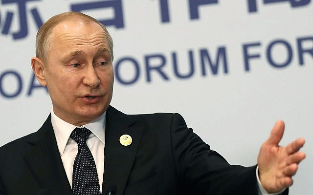 Russian President Vladimir Putin gestures while speaking the the media after the Belt and Road Forum in Beijing, China, April 27, 2019 (Sergei Ilnitsky/Pool Photo via AP)