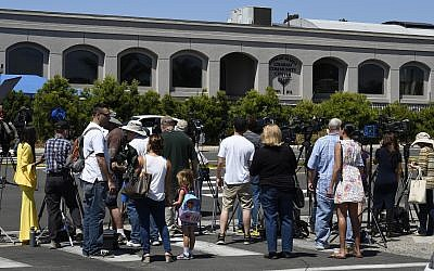 Neighbors and media members gather outside of the Chabad of Poway Synagogue, April 27, 2019, in Poway, California. (AP/Denis Poroy)