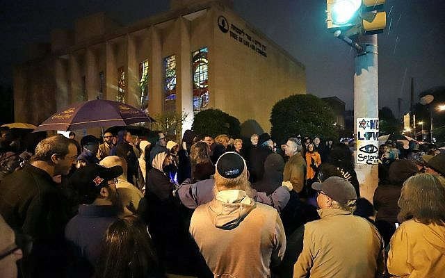 A group gathers outside the Tree of Life Synagogue in Pittsburgh, Pennsylvania, for a vigil to honor the victims of a shooting attack on another synagogue in Poway, California, on April 27, 2019. (AP/Gene J. Puskar)