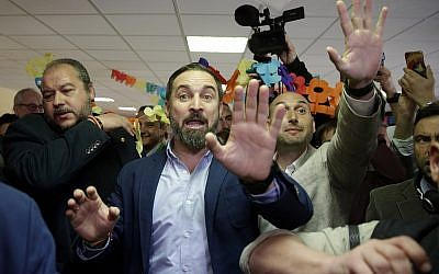 Santiago Abascal, center, leader of far right party Vox, gestures after casting his ballot at a polling station for Spain's general election in Madrid, Sunday, April 28, 2019. (AP Photo/Andrea Comas)