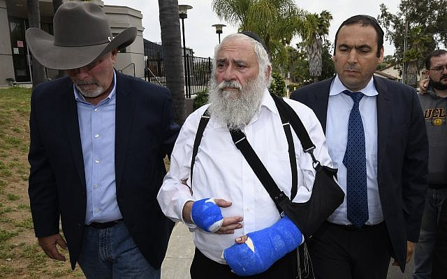 Rabbi Yisroel Goldstein, center, arrives for a news conference at the Chabad of Poway synagogue, April 28, 2019, in Poway, Calif. (AP/Denis Poroy)