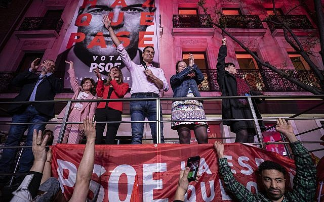 Spain's Prime Minister and Socialist Party leader Pedro Sanchez gestures to supporters outside the party headquarters following the general election in Madrid, Spain, Sunday, April 28, 2019. (AP Photo/Bernat Armangue)