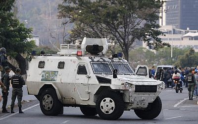 A military vehicle blocks an avenue next to La Carlota air base in Caracas, Venezuela, April 30, 2019 (AP Photo/Ariana Cubillos)