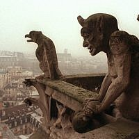 Gargoyles watch over the streets of Paris from the top of the 11th century Notre Dame cathedral, January 10, 1997. (AP/Remy de la Mauviniere)