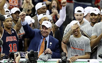 Head coach Bruce Pearl of the Auburn Tigers celebrates with his team after defeating the Kentucky Wildcats 77-71 in the 2019 NCAA Basketball Tournament Midwest Regional at Sprint Center on March 31, 2019 in Kansas City, Missouri. (Christian Petersen/Getty Images via JTA)