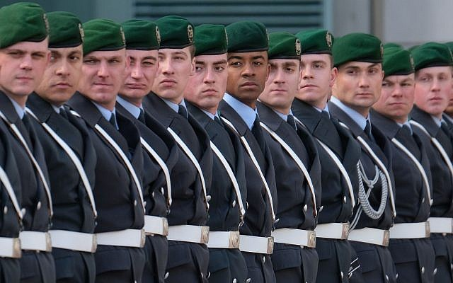Soldiers of the Bundeswehr arrive for the state visit of a foreign leader at the Chancellery on March 13, 2019 in Berlin, Germany. (Sean Gallup/Getty Images via JTA)