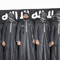 A photo published on the Islamic State terror groups propaganda outlet, the Amaq agency, on April 23, 2019, showing what the group says is eight bombers who carried out the Easter attacks in Sri Lanka. (Amaq)