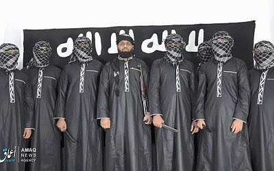 A photo published on the Islamic State terror group's propaganda outlet, the Amaq agency, on April 23, 2019, showing what the group says is eight bombers who carried out the Easter attacks in Sri Lanka. (Amaq)