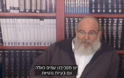Rabbi Eliezer Kashtiel, the head of the pre-military academy in the West Bank settlement in Eli. (screen capture: Channel 13)