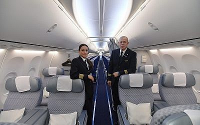 Illustrative: El Al flight attendants stand inside the Boeing 737-900ER aircraft at the Ben Gurion International Airport on October 23, 2013.(Yossi Zeliger/FLASH90)