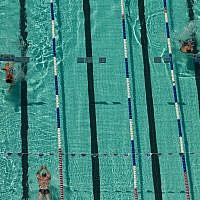 ILLUSTRATIVE - Swimmers at the Gordon Pool in Tel Aviv, September 11, 2014 (Miriam Alster/FLASH90)