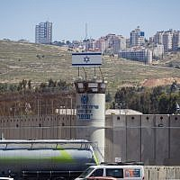 The Israeli flag seen on top of the Ofer military prison, near the West bank city of Ramallah,  May 01, 2015 (Miriam Alster/Flash90)
