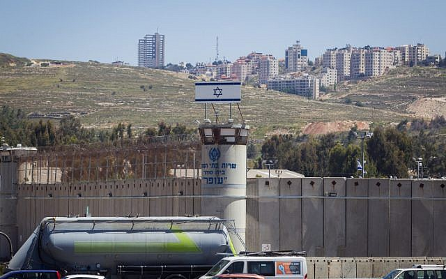 The Israeli flag seen on top of the Ofer military prison, near the West Bank city of Ramallah, May 1, 2015 (Miriam Alster/Flash90)