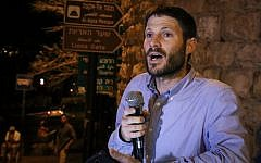 MK Bezalel Smotrich speaks during a demonstration outside Jerusalem's Old City, calling for Jews to be allowed to pray there, on July 25, 2015. (Gershon Elinson/Flash90)