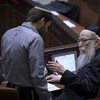 Then-Jewish Home MK Bezalel Smotrich, left, speaks with then-health minister Yaakov Litzman during a plenary session in the Knesset on January 25, 2017. (Yonatan Sindel/Flash90)
