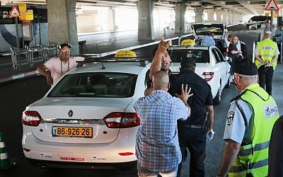 Illustrative: Taxis drivers at Ben Gurion Airport outside of Tel Aviv June 12, 2017. (FLASH9)