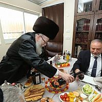 Avigdor Liberman is hosted by UTJ leader Yaakov Litzman at a celebration on June 18, 2017. (Shlomi Cohen/Flash90)