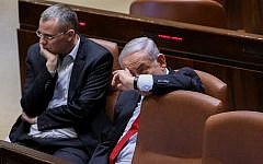 Prime Minister Benjamin Netanyahu with Tourism Minister Yariv Levin in the Knesset on February 13, 2018 (Yonatan Sindel/Flash90)