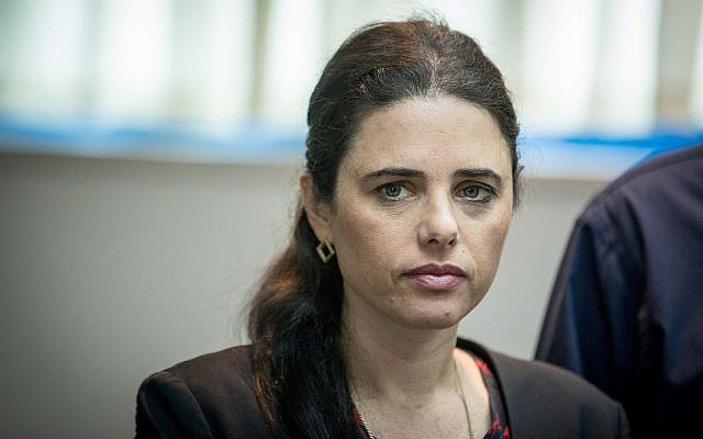 Justice Minister Ayelet Shaked is presented with the state comptroller's annual report at the Ministry of Justice in Jerusalem on March 24, 2019. (Yonatan Sindel/Flash90)