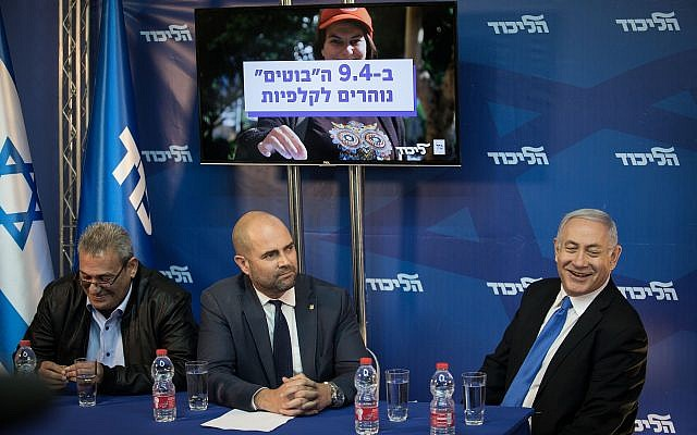 Prime Minister Benjamin Netanyahu welcomes far-right Likud supporter Giora Ezra to the podium at a press conference, at the Prime Minister's Residence in Jerusalem, on April 1, 2019. (Hadas Parush/Flash90)