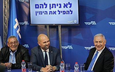 Prime Minister Benjamin Netanyahu and Likud MK Amir Ohana (center) speak to the media about an alleged fake media campaign, at the Prime Minister's Residence in Jerusalem on April 1, 2019. At left is Giora Ezra, who runs the Captain George twitter account. The slogan on the screen above them reads: We won't let them bring down the Right. (Hadas Parush/Flash90)