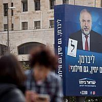An election campaign poster showing Yisrael Beytenu head Avigdor Liberman, in Jerusalem on April 2, 2019 (Yonatan Sindel/Flash90)