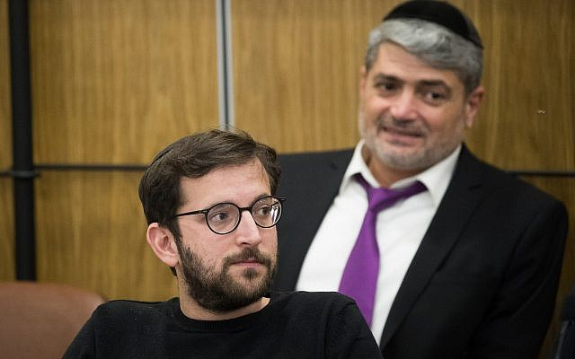 Likud campaign manager Jonathan Orich (front) and Likud campaigner Yitzhak Haddad (back) attend a Central Elections Committee meeting at the Knesset on April 3, 2019. (Yonatan Sindel/Flash90)