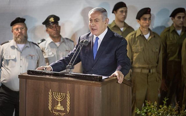 Prime Minister Benjamin Netanyahu speaks during the funeral of Zachary Baumel at the Mount Herzl military cemetery in Jerusalem on April 4, 2019. (Hadas Parush/Flash90)